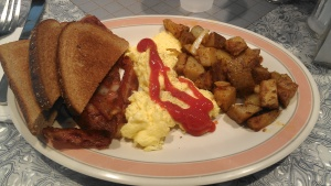 "Never mind how delicious the eggs, bacon and home fries were (and they were scrumptious!!!).......how could anyone NOT enjoy a meal with Sam Cooke (""Bring It On Home To Me"") and Elvis (""Jailhouse Rock"") playing in the background???"