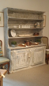 This hutch is new, but I love the color and its aged look.